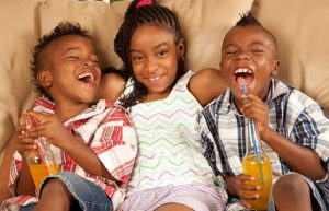 three siblings laughing. End sibling rivalry